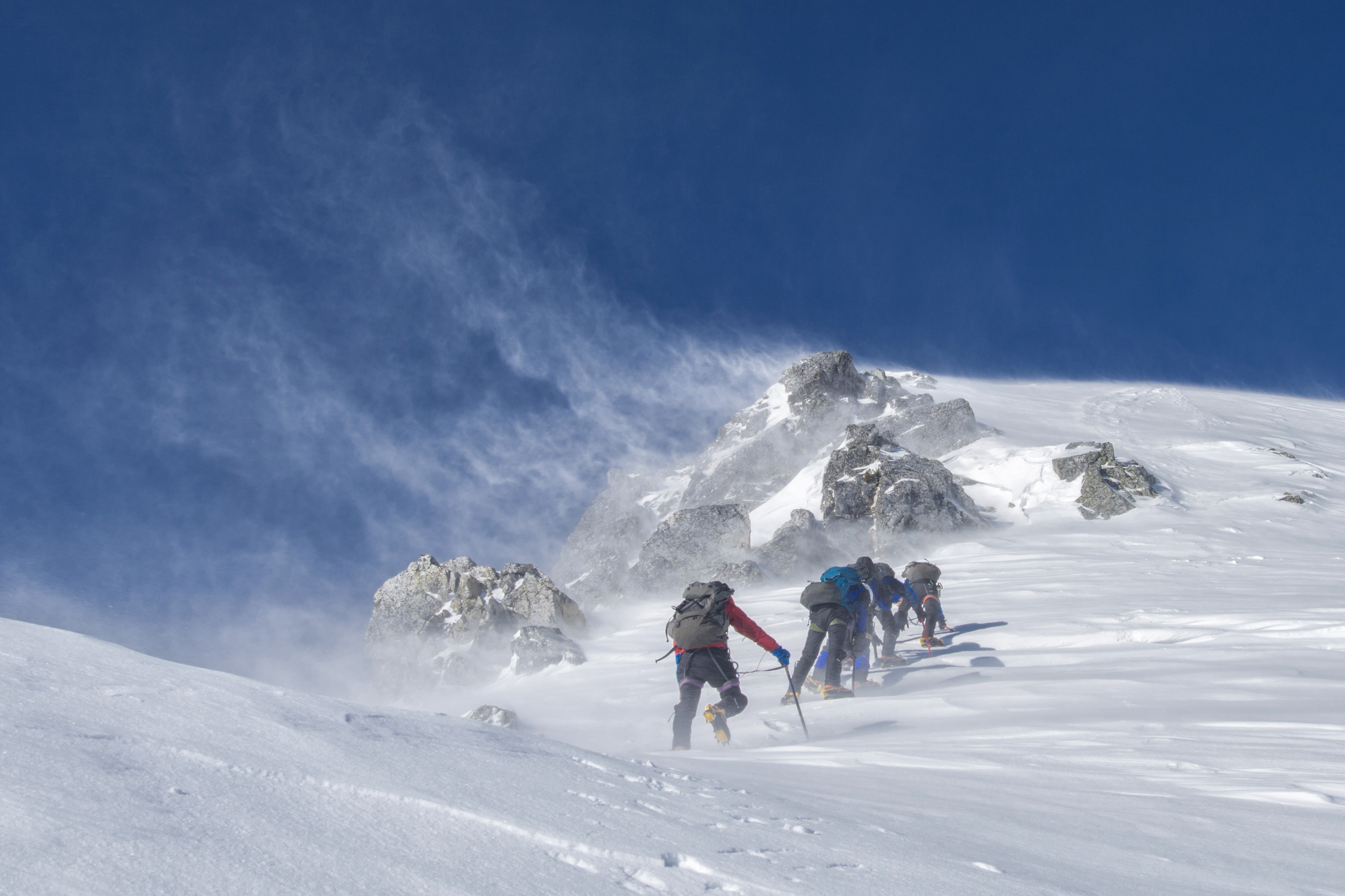 team climbing in the snow